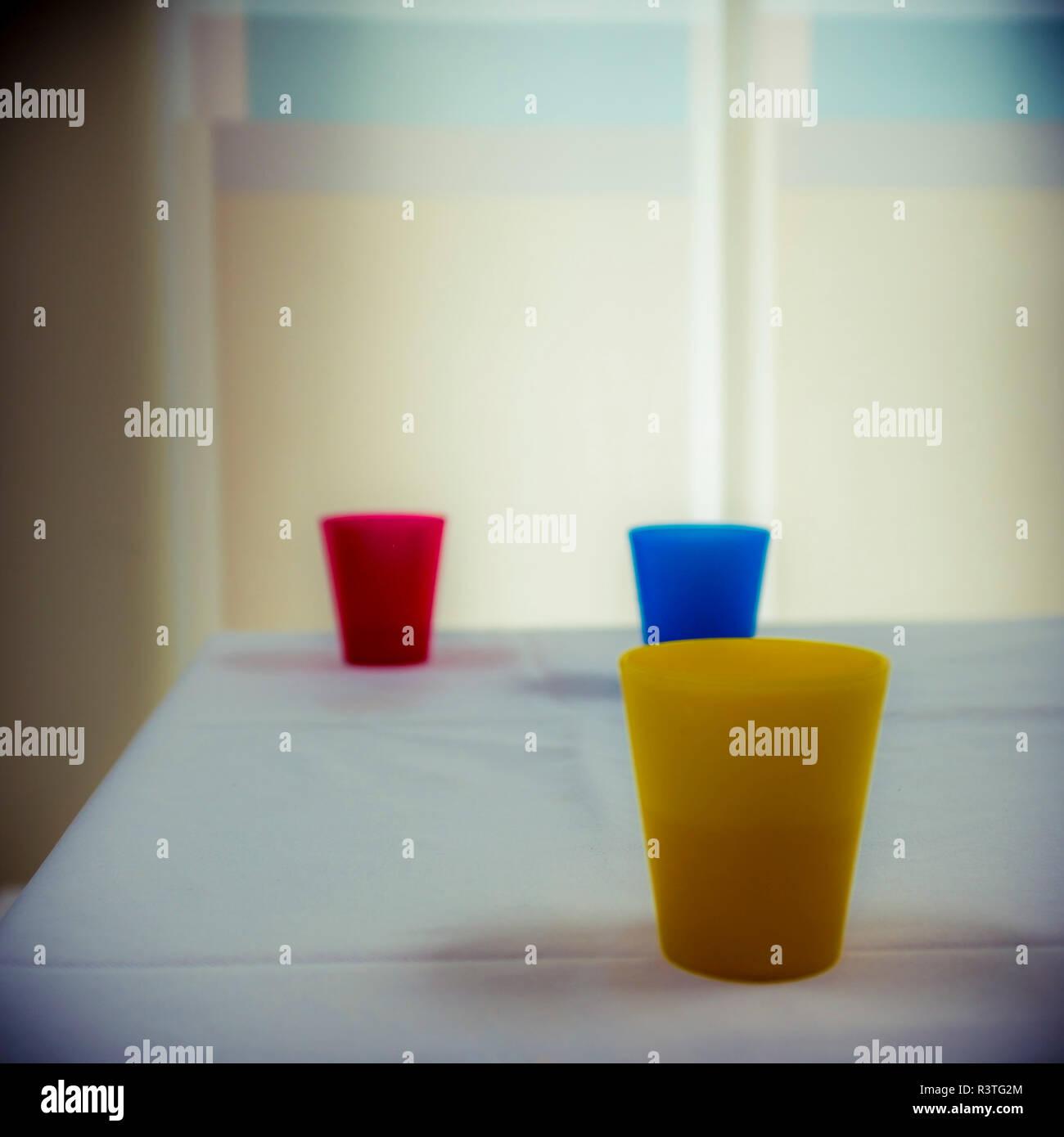 Still life of three plastic cups - Stock Image