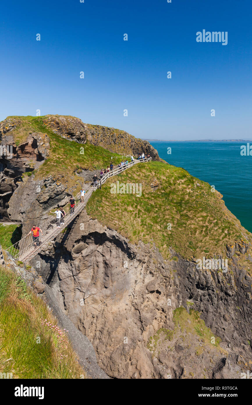 UK, Northern Ireland, County Antrim, Ballintoy, pathway to the Carrick-a-Rede Rope Bridge - Stock Image