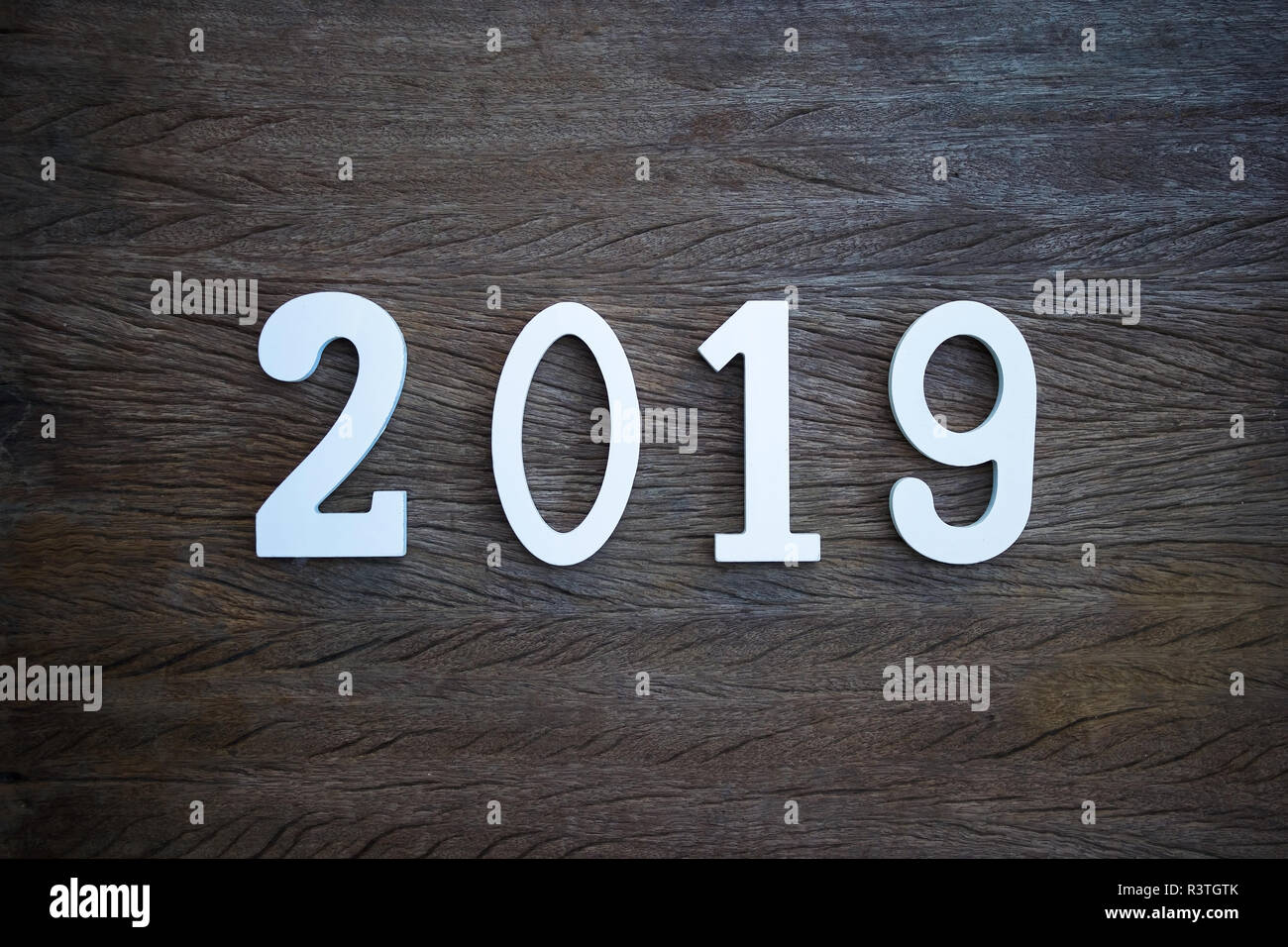happy new year 2019 background concept cut wood number 2019 on old wooden table from top view with space for text web banner wallpaper decoration