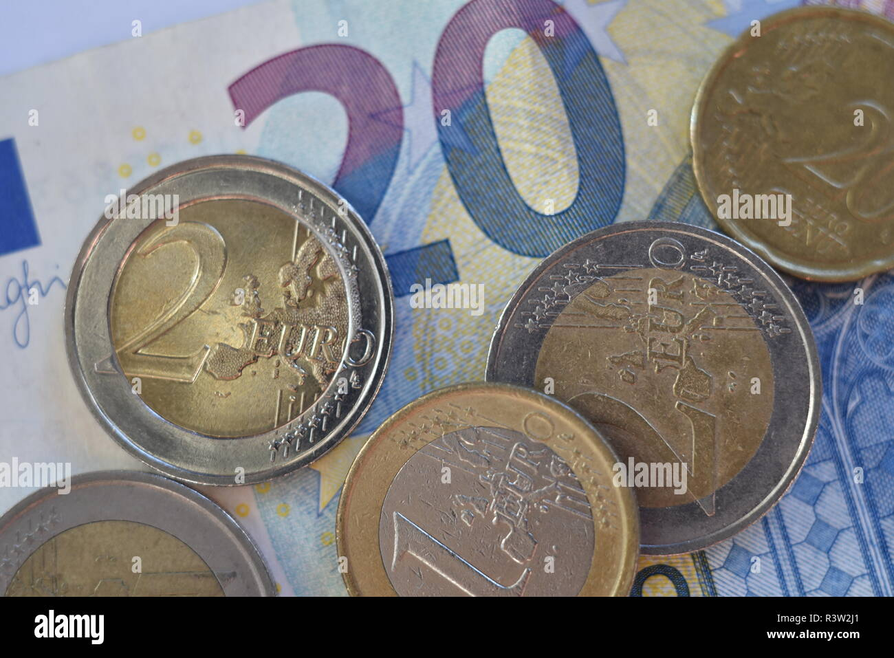 Euro coins on a 20 euro note - Stock Image