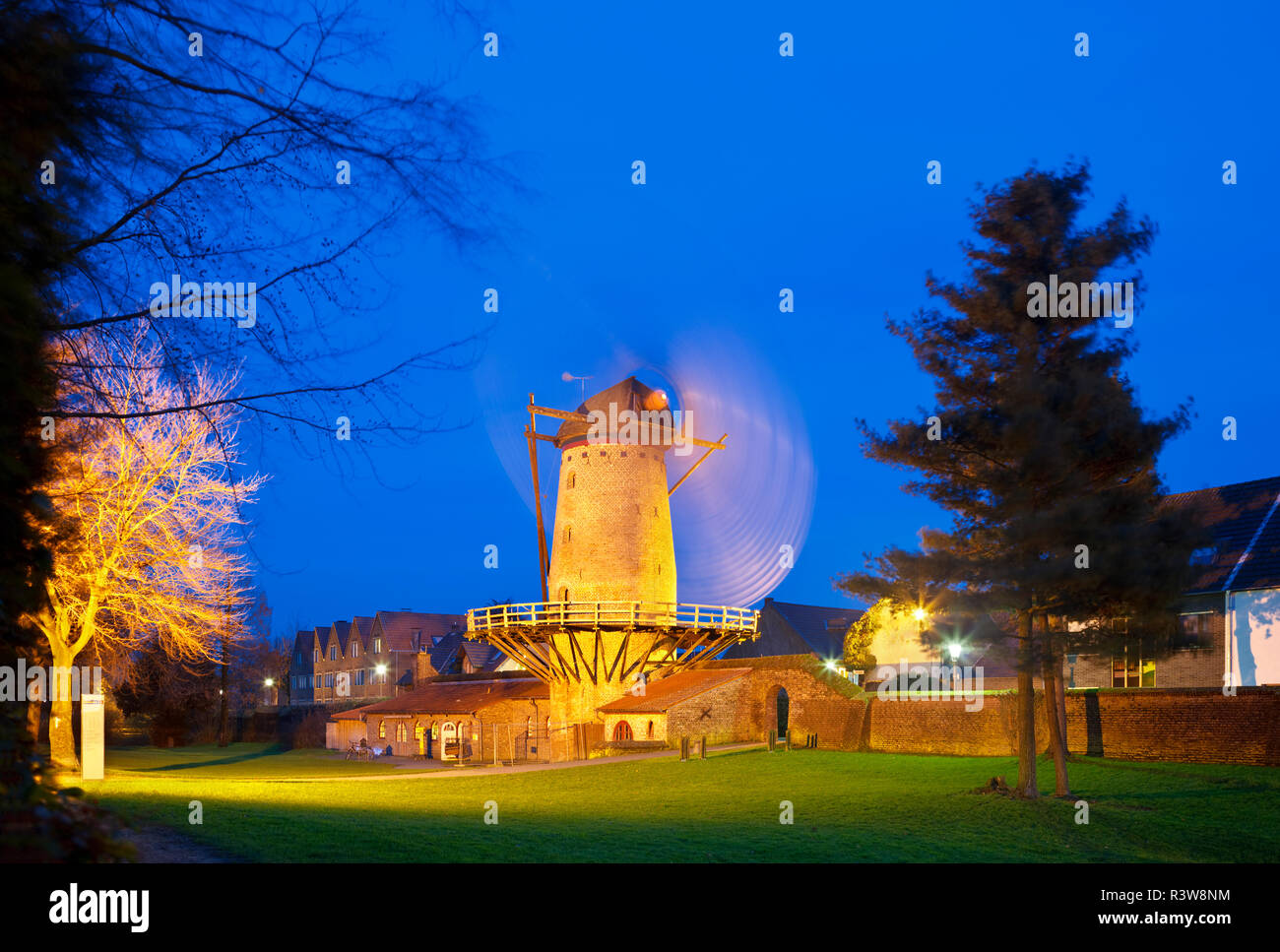 The old Kriemhild Windmill (Kriemhild-Muehle) is part of the surrounding wall of Xanten, Germany. Night shot with deep blue sky. - Stock Image