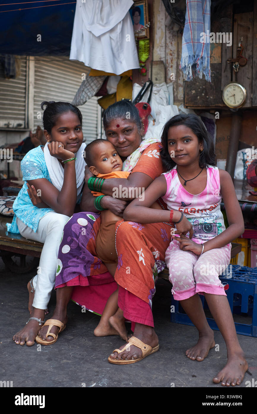 A happy family of so-called pavement dwellers or homeless, neat Mumbadevi Temple in Mumbai, India - Stock Image