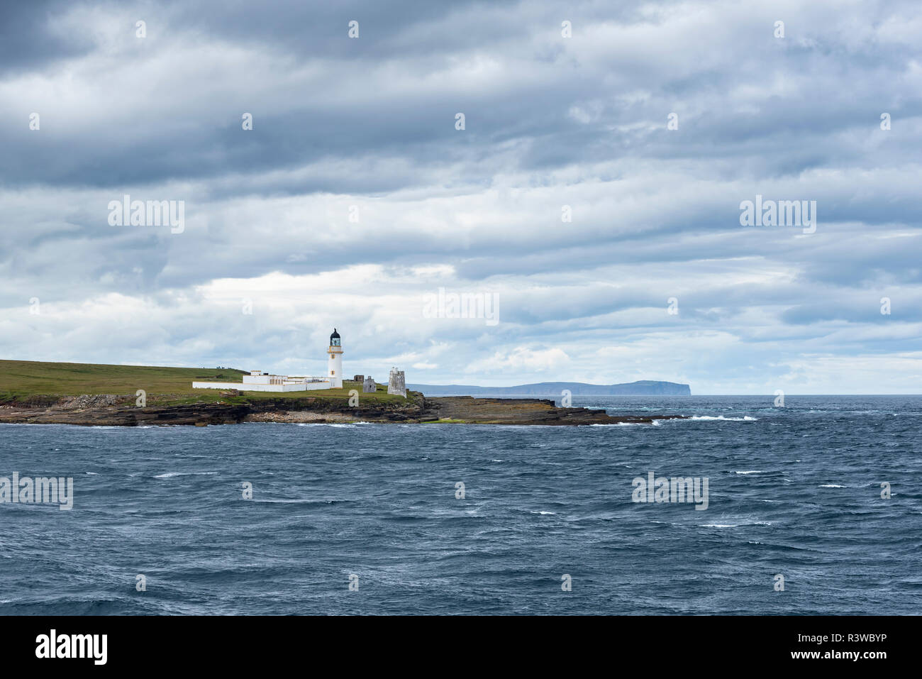 Great Britain, Scotland, Isle of Stroma, Lighthouse, Pentland Firth, Dunnet Head in the background - Stock Image
