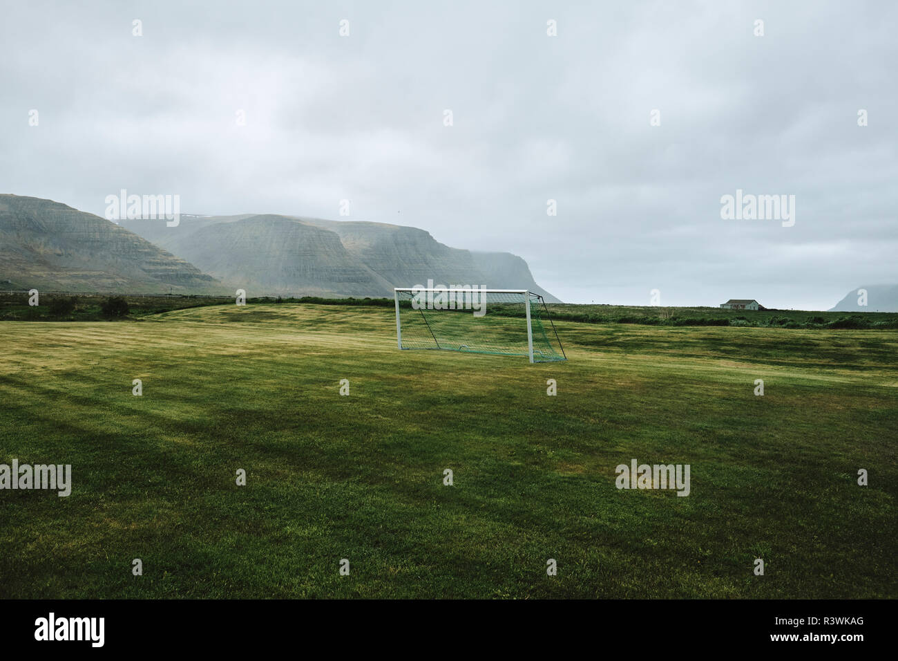 A lone empty football pitch and goal in the remote and barren Iceland landscape. - Stock Image