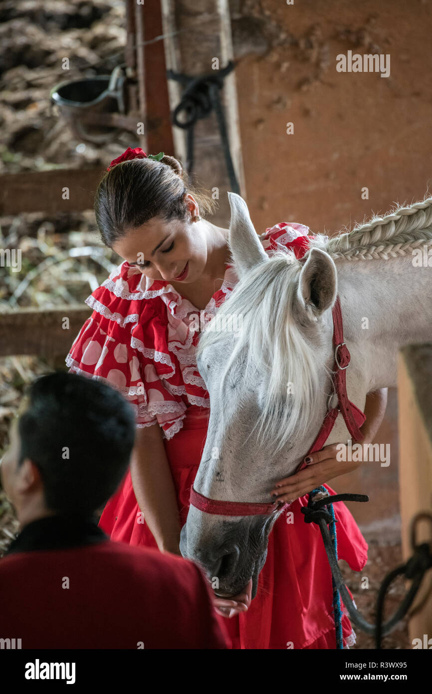 Central America, Costa Rica, Alajuela Province, Rancho San Miguel. Woman in typical Spanish attire with gray Andalusian horse. (Editorial Use Only) - Stock Image