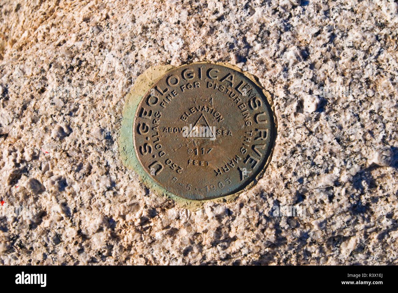 USGS survey marker on the summit of Sentinel Dome, Yosemite National Park, California, USA - Stock Image