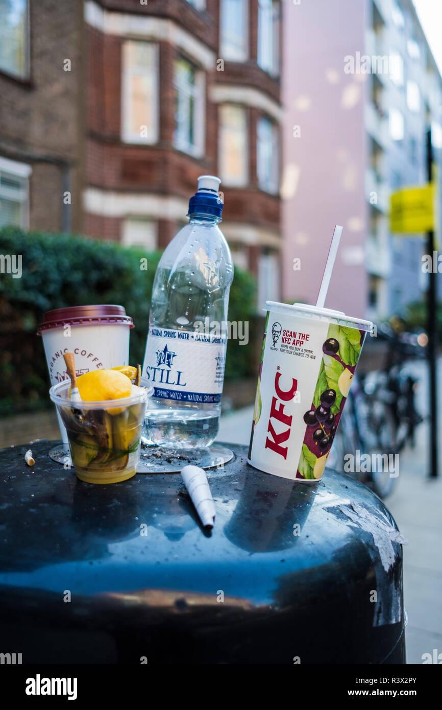 Rubbish on top of street bin, Borough of Camden, London, England, U.K. Stock Photo