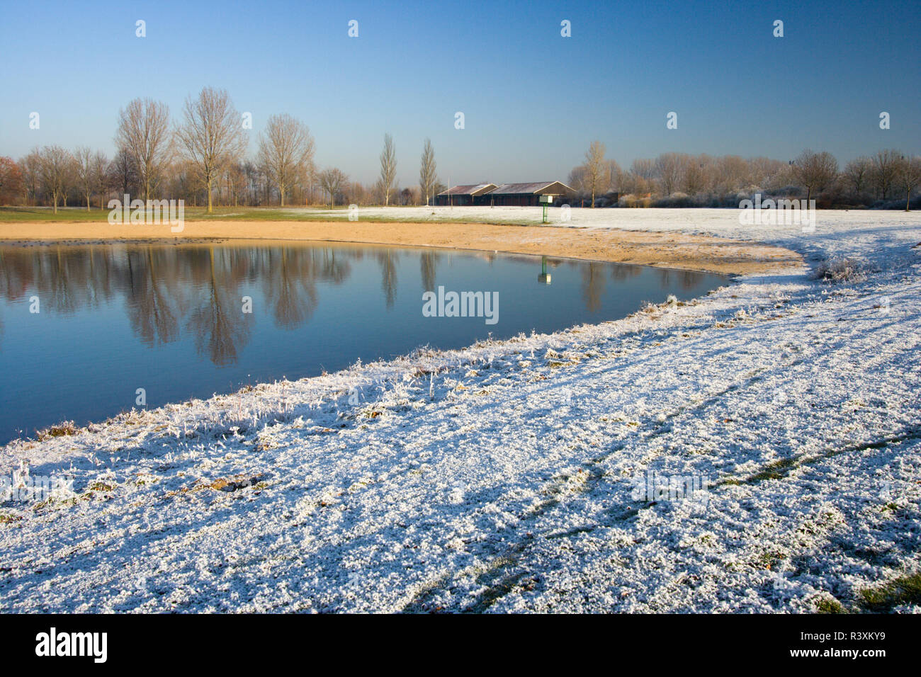A swimming lake in wintertime. Auesee in Wesel, Germany - Stock Image