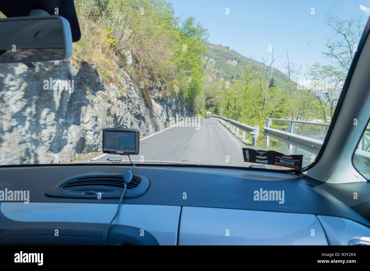 View through front window of a car. SIXT waiver and TomTom satnav sticking on the glass - Stock Image