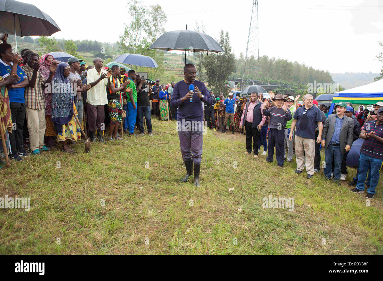 """(181124) -- KAMONYI (RWANDA), Nov. 24, 2018 (Xinhua) -- Rwandan Foreign Minister Richard Sezibera (C) speaks during monthly community work, Umuganda, in Kamonyi district, central Rwanda, on Nov. 24, 2018. Diplomatic missions in Rwanda and Rwandan Ministry of Foreign Affairs and International Cooperation on Saturday organized a diplomatic Umuganda in Kamonyi. Taking root from Rwandan culture of self-help and cooperation, Umuganda, held on the last Saturday of the month, can be translated as """"coming together in common purpose to achieve an outcome,"""" according to Rwanda Governance Board. (Xinhua/ Stock Photo"""