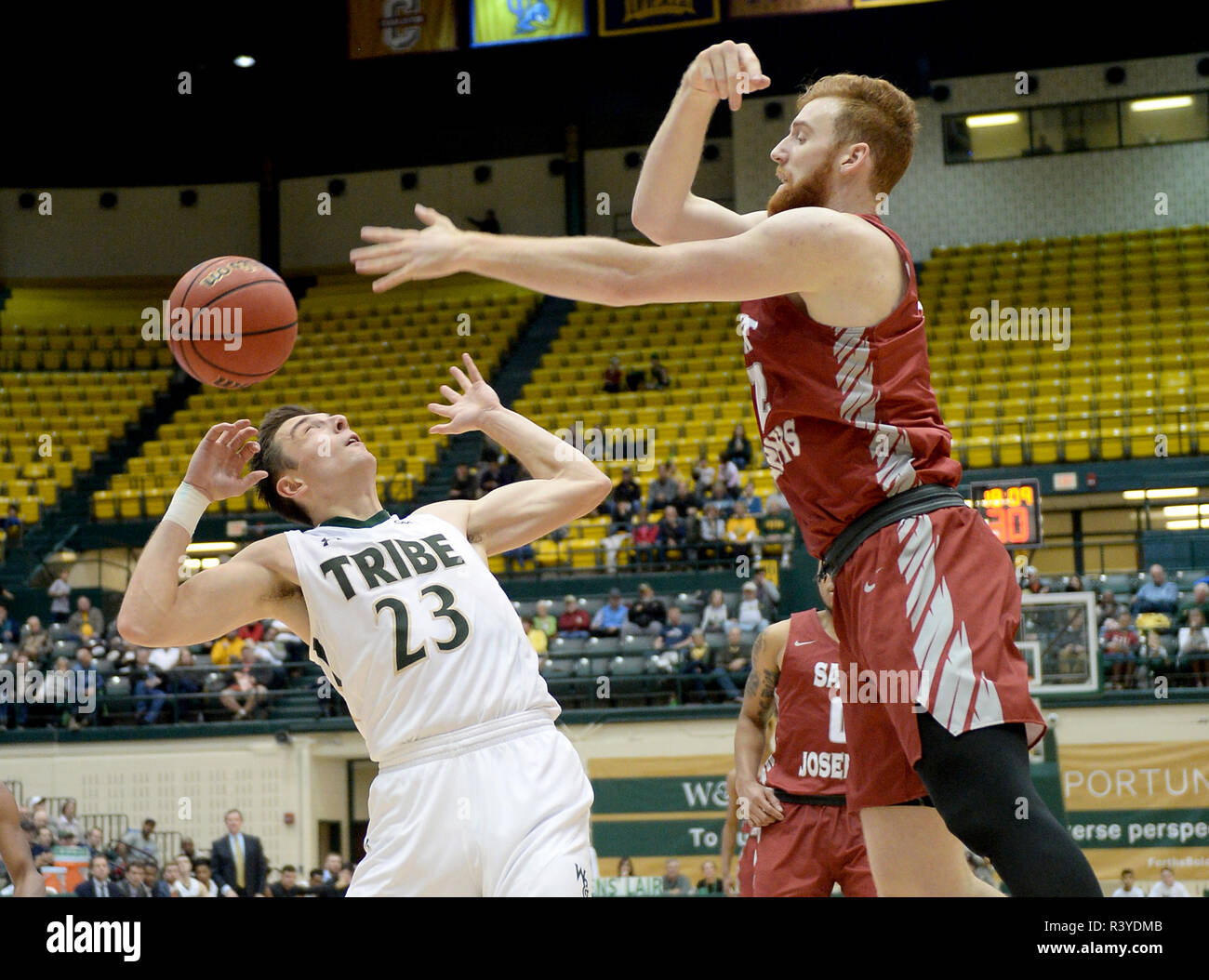 Williamsburg, VA, USA. 24th Nov, 2018. 20181124 - William and Mary forward JUSTIN PIERCE (23) and St. Joseph's forward ANTHONY LONGPRE (12) go for a rebound in the second half at Kaplan Arena in Williamsburg, Va. Credit: Chuck Myers/ZUMA Wire/Alamy Live News - Stock Image