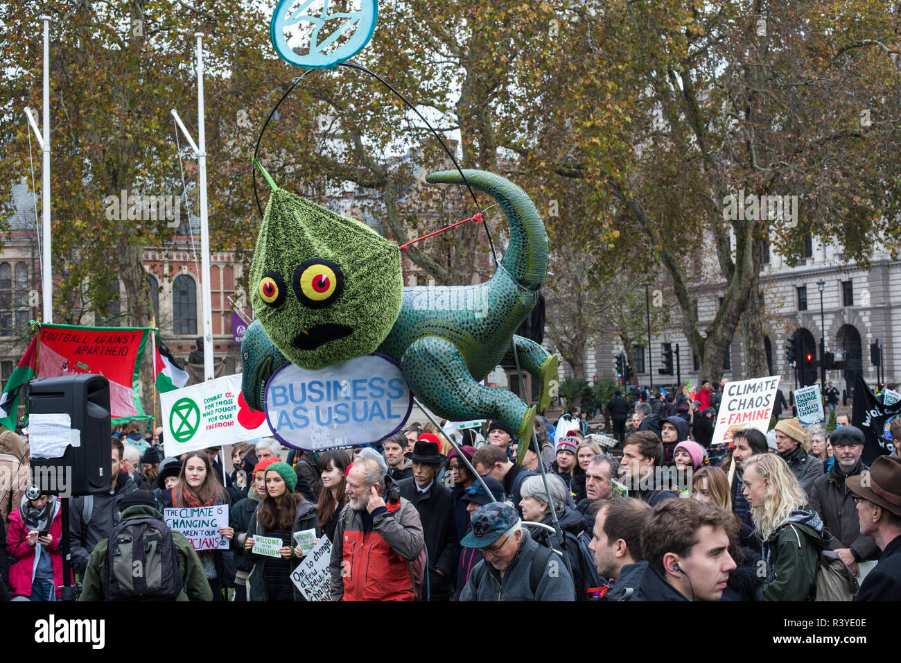 London, UK. 24th November, 2018. Environmental campaigners from Extinction Rebellion attend a Rebellion Day 2 event to highlight 'criminal inaction in the face of climate change catastrophe and ecological collapse' by the UK Government as part of a programme of civil disobedience during which scores of campaigners have been arrested. The event comprised a funeral ceremony in Parliament Square followed by a procession to Downing Street and Buckingham Palace. Credit: Mark Kerrison/Alamy Live News - Stock Image