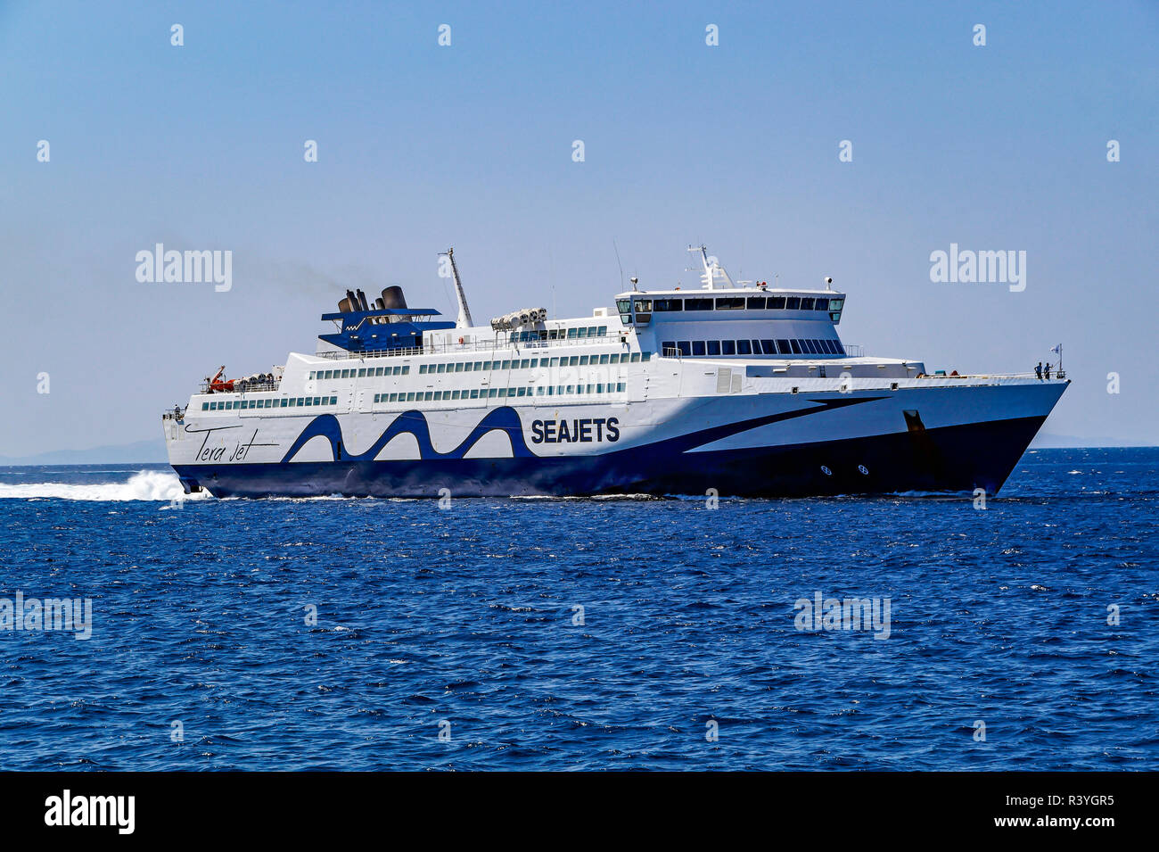 Sea Jets Tera Jet car and passenger ferry arrives at harbour Mykonos town on island Mykonos in the Cyclades group in the Aegean Sea Greece - Stock Image