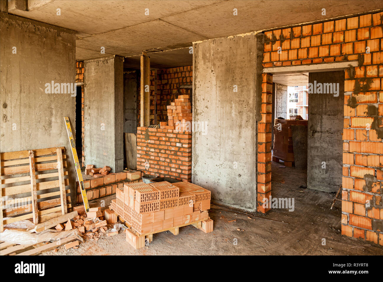 Bricklaying Of Walls In A High Rise Building Interior And Exterior Brick Walls In The Concrete Box Of The House Stock Photo Alamy