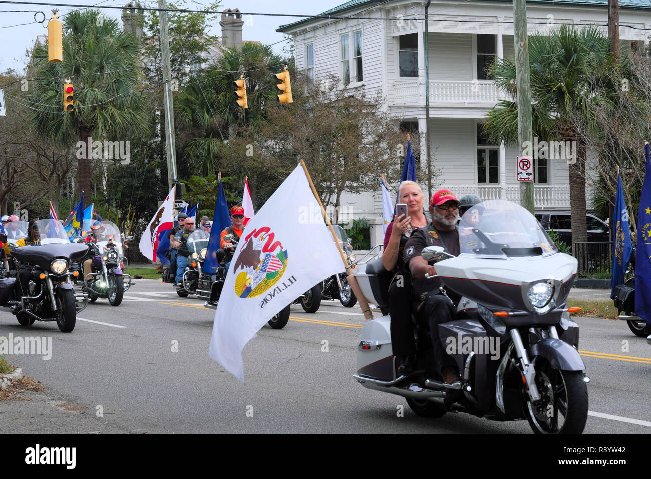 U.S. Veterans Day Parade of Motorcycles with Flags Flying Stock Photo