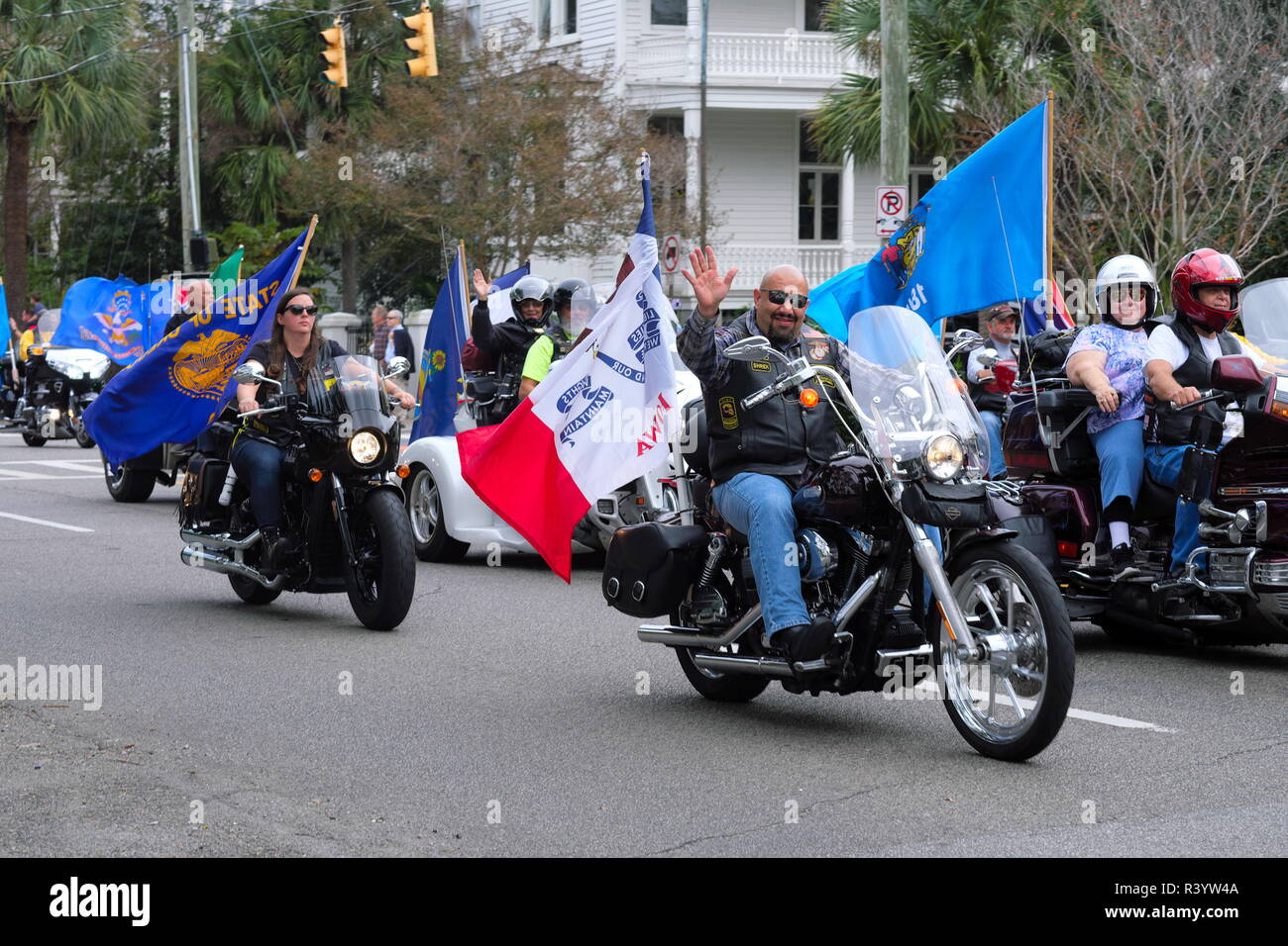 U.S. Veterans Day Parade of Motorcycles with Flags Flying - Stock Image