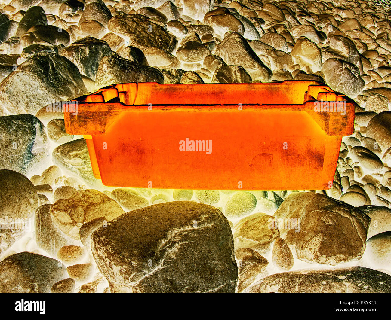 Dangerous garbage ejected from the sea on remote beaches. Environmental contamination with toxic mess..  Hipster filter. Stock Photo