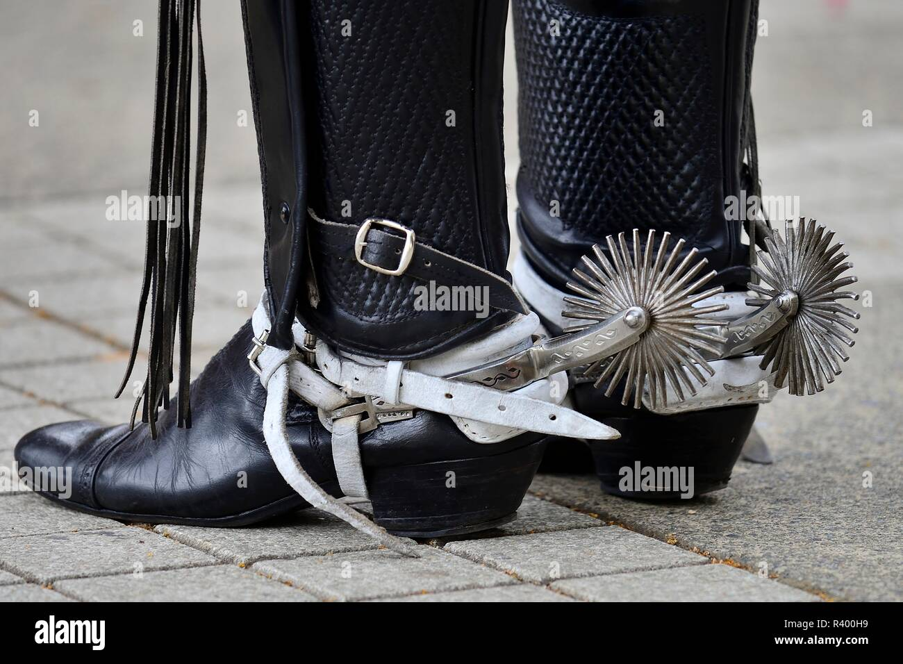 Man in riding boots with spurs, detail, island Chiloé, Chile - Stock Image
