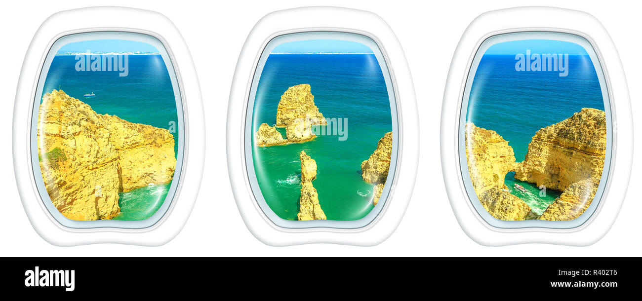 Porthole frame windows interior flying on scenic landscape of boat trip between cliffs and natural rock formations of Ponta da Piedade. Aerial view with white background copy space. Stock Photo
