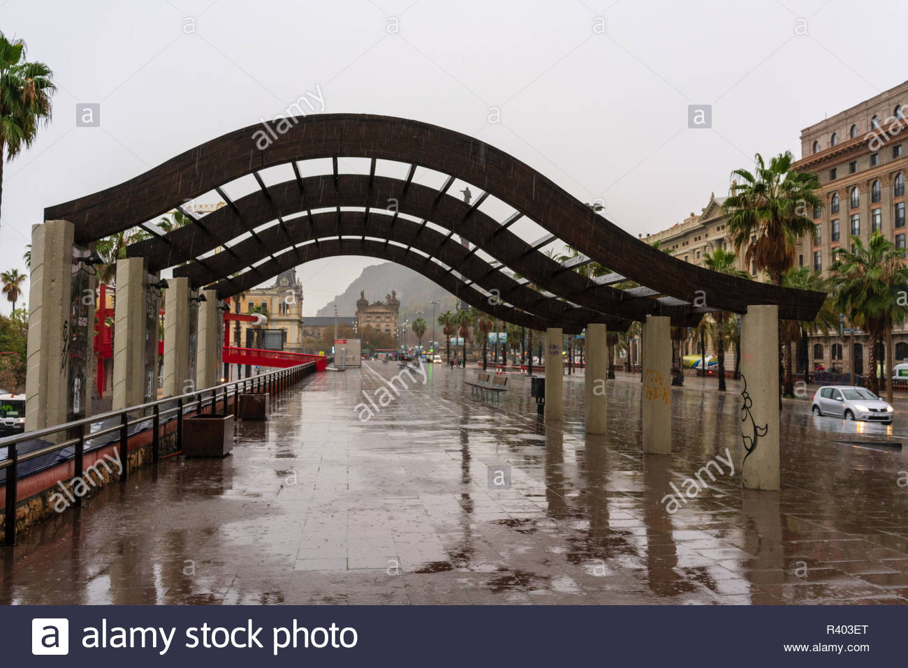 A rainy day in Barcelona City, along the road by the port looking toward Mont Juic, Barcelona City - Stock Image