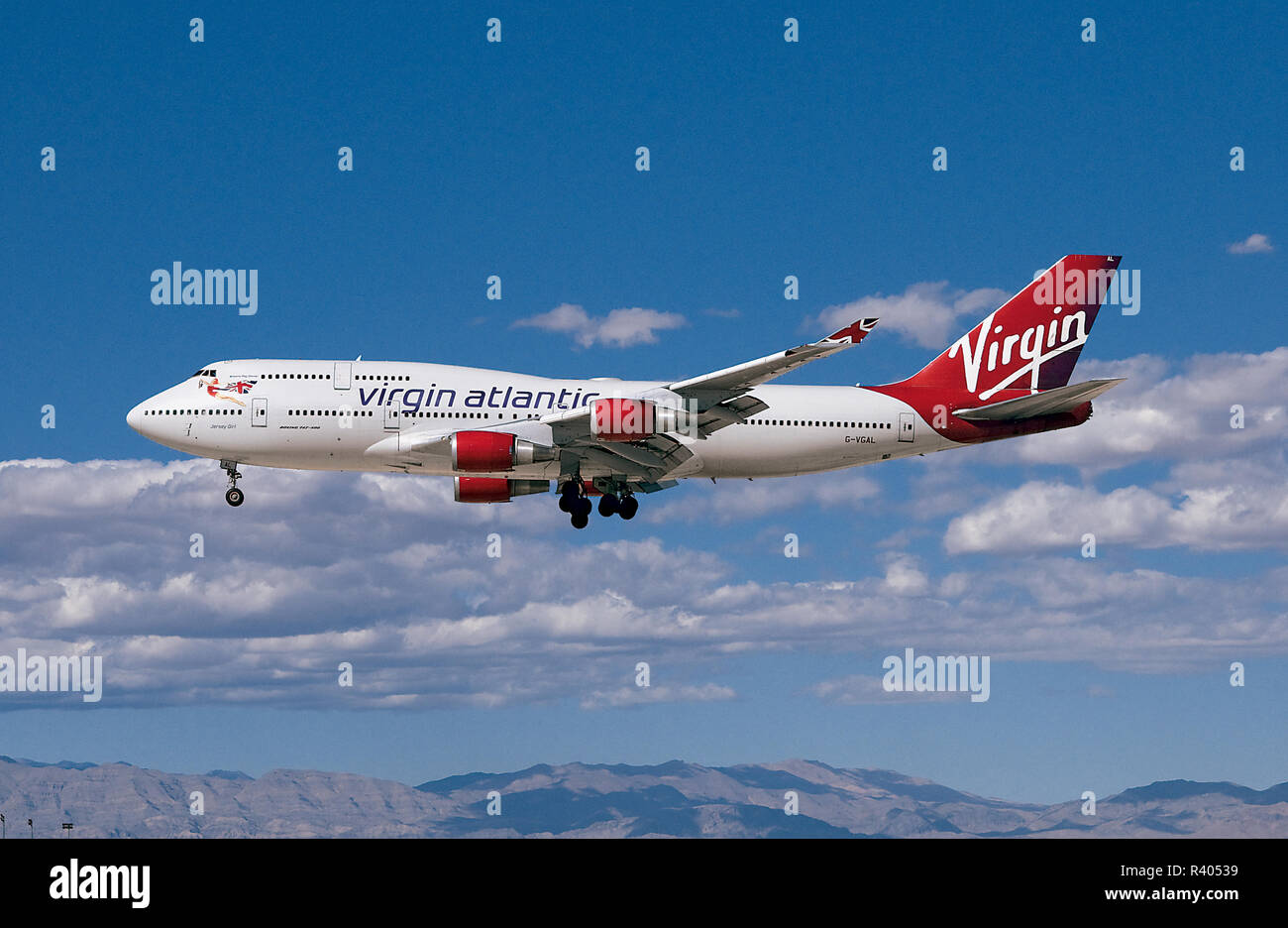 Virgin Atlantic Beoeing 747 Jumbo Jet Flying beneath a Beautiful Sky Stock Photo