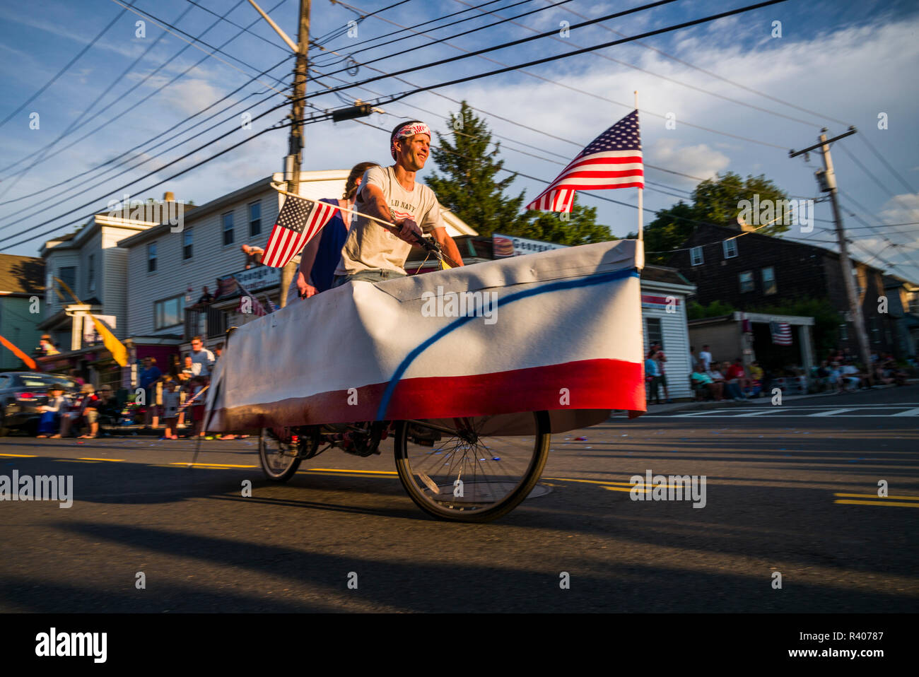 USA, Massachusetts, Cape Ann, Gloucester, Fourth of July parade, boat-shaped bicycle Stock Photo