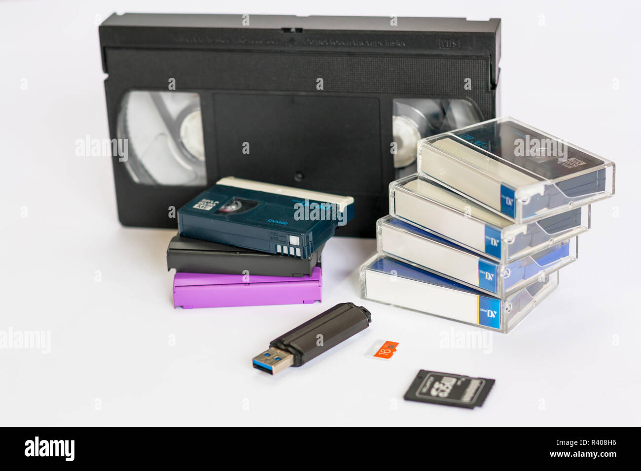 MiniDV  and  VHS video tape isolated on white.  SD and MicroSD cards. Cassettes. USB 3.0 pendrive. Stock Photo