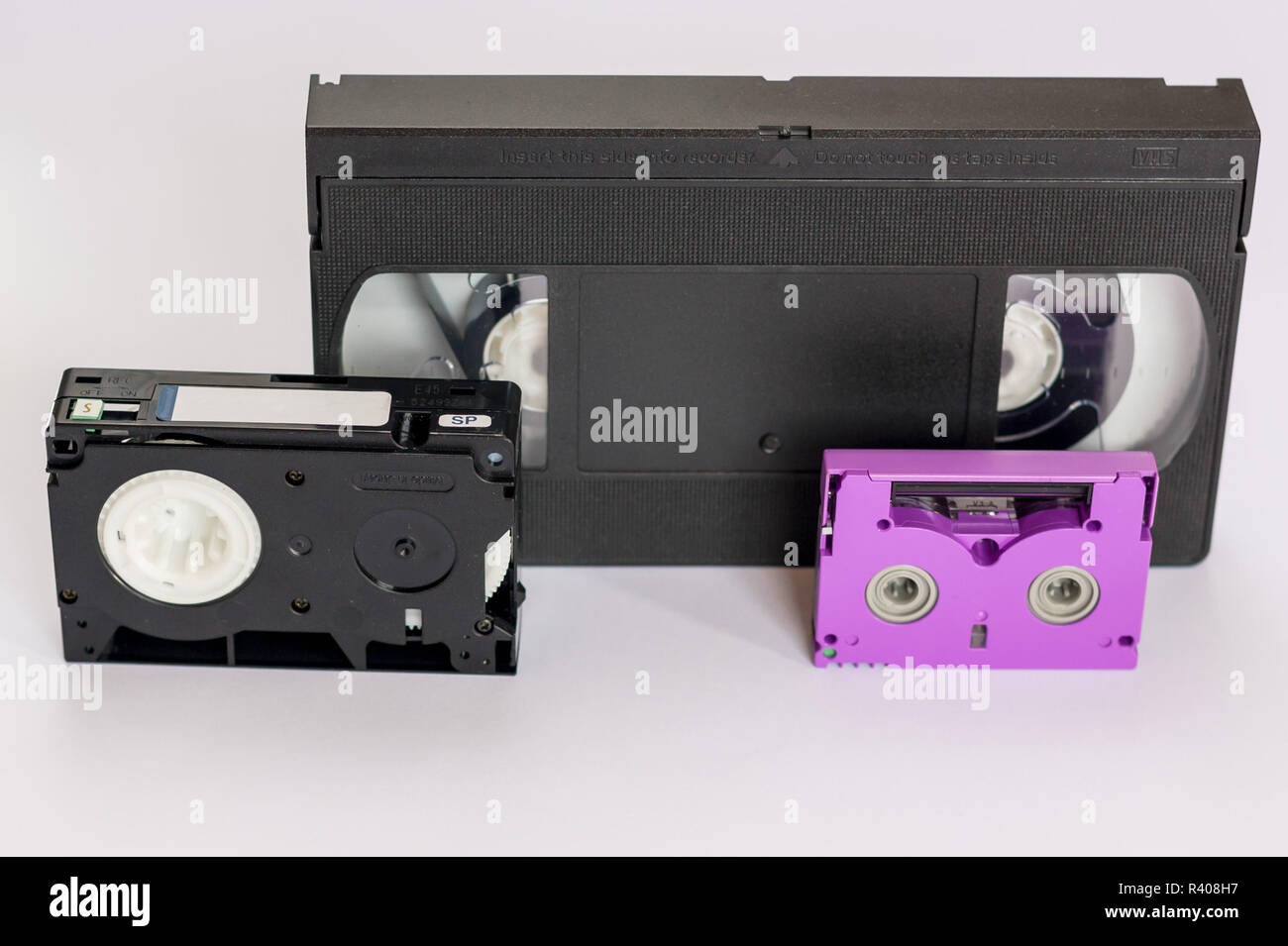 MiniDV and  VHS video tape isolated on white. Cassettes. Stock Photo