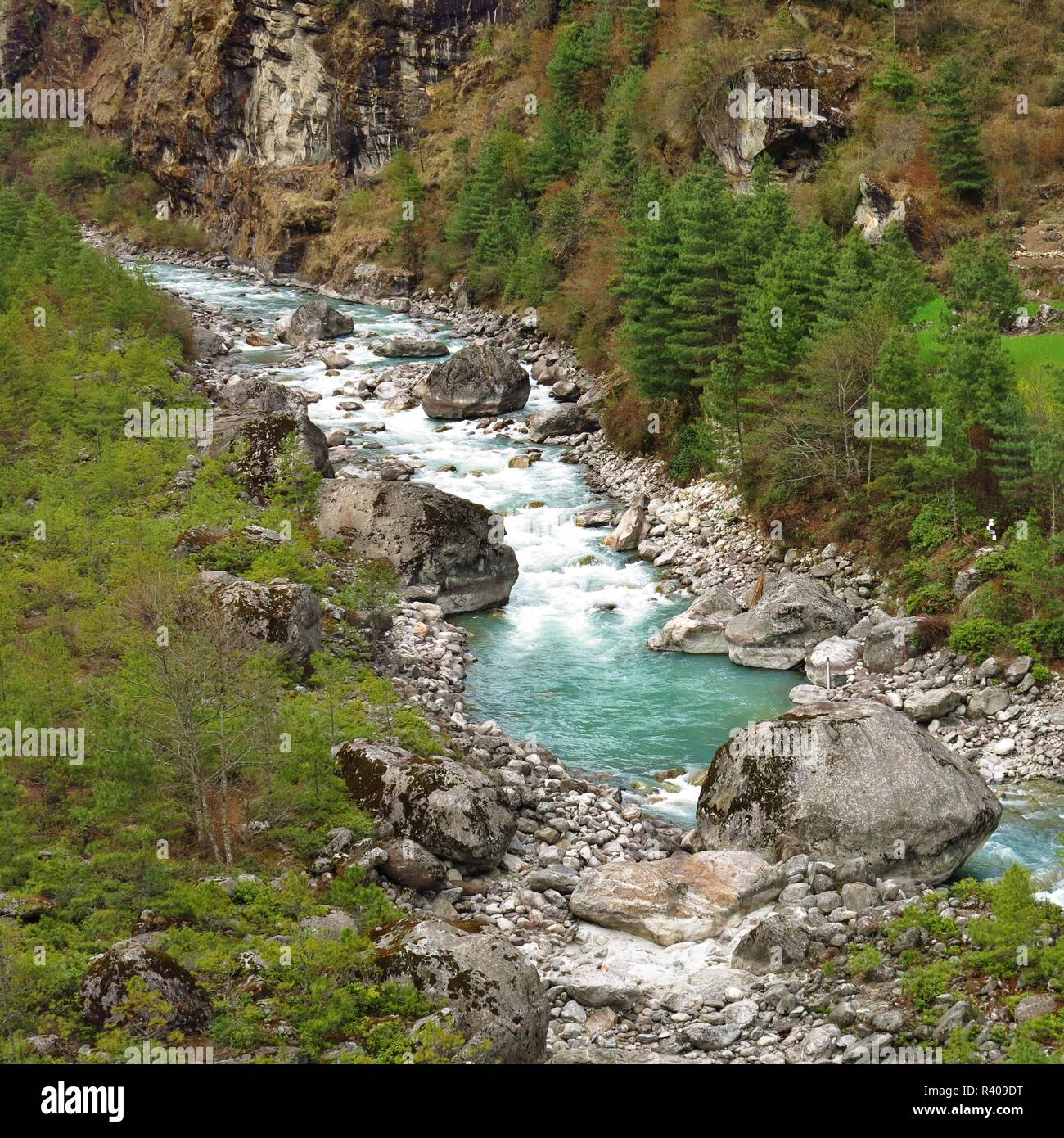 Turquoise colored river Dudh Kosi. Mount Everest National Park, Nepal. - Stock Image