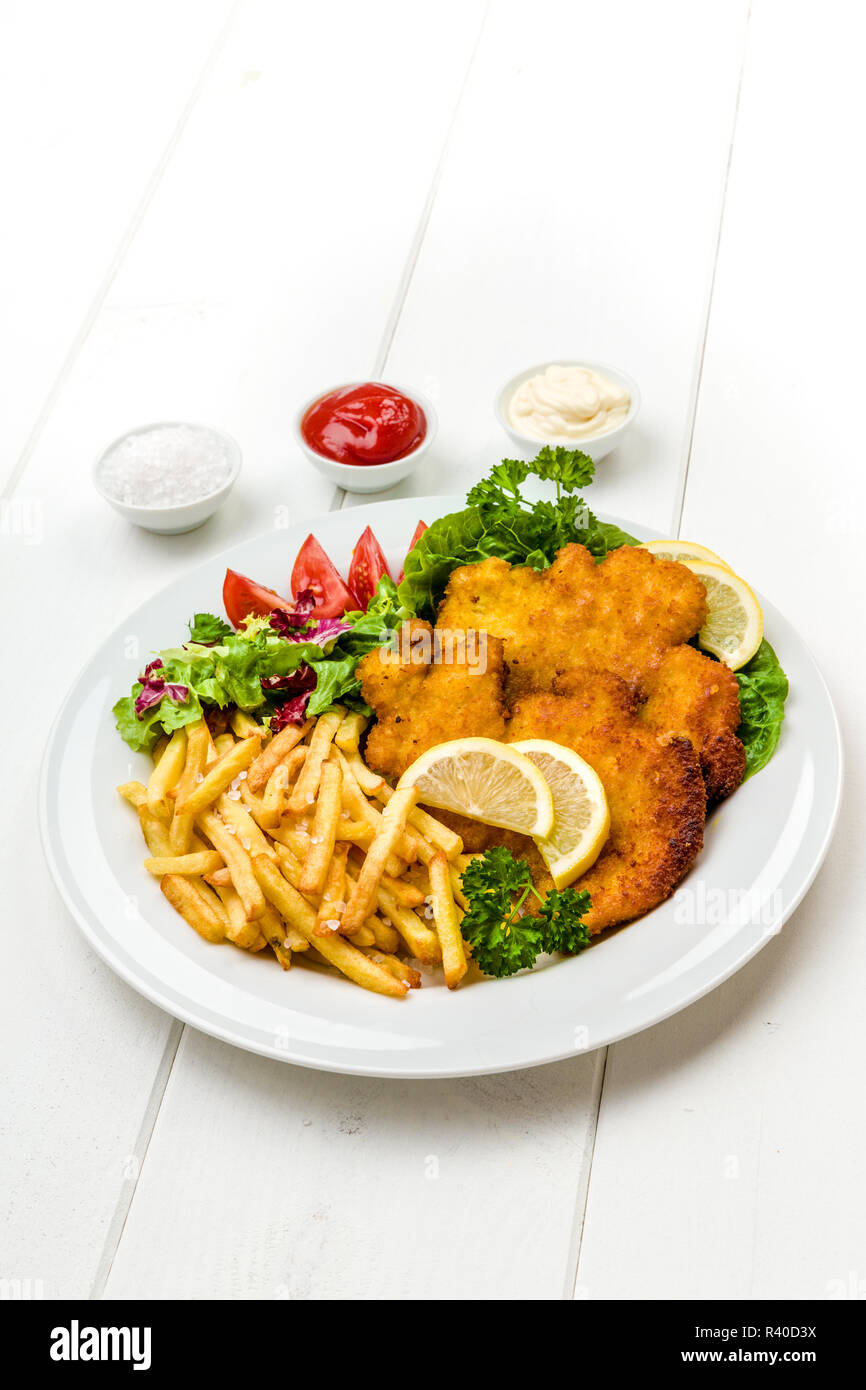 Chicken Schnitzel With Chips And Salad Stock Photo Alamy