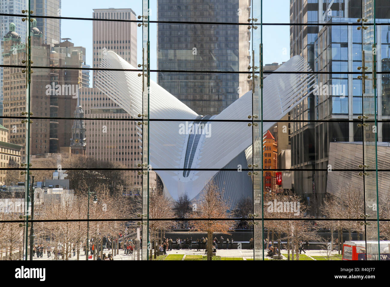 The National September 11 Memorial Museum (white structure) seen through windows at Brookfield Place, New York, USA - Stock Image
