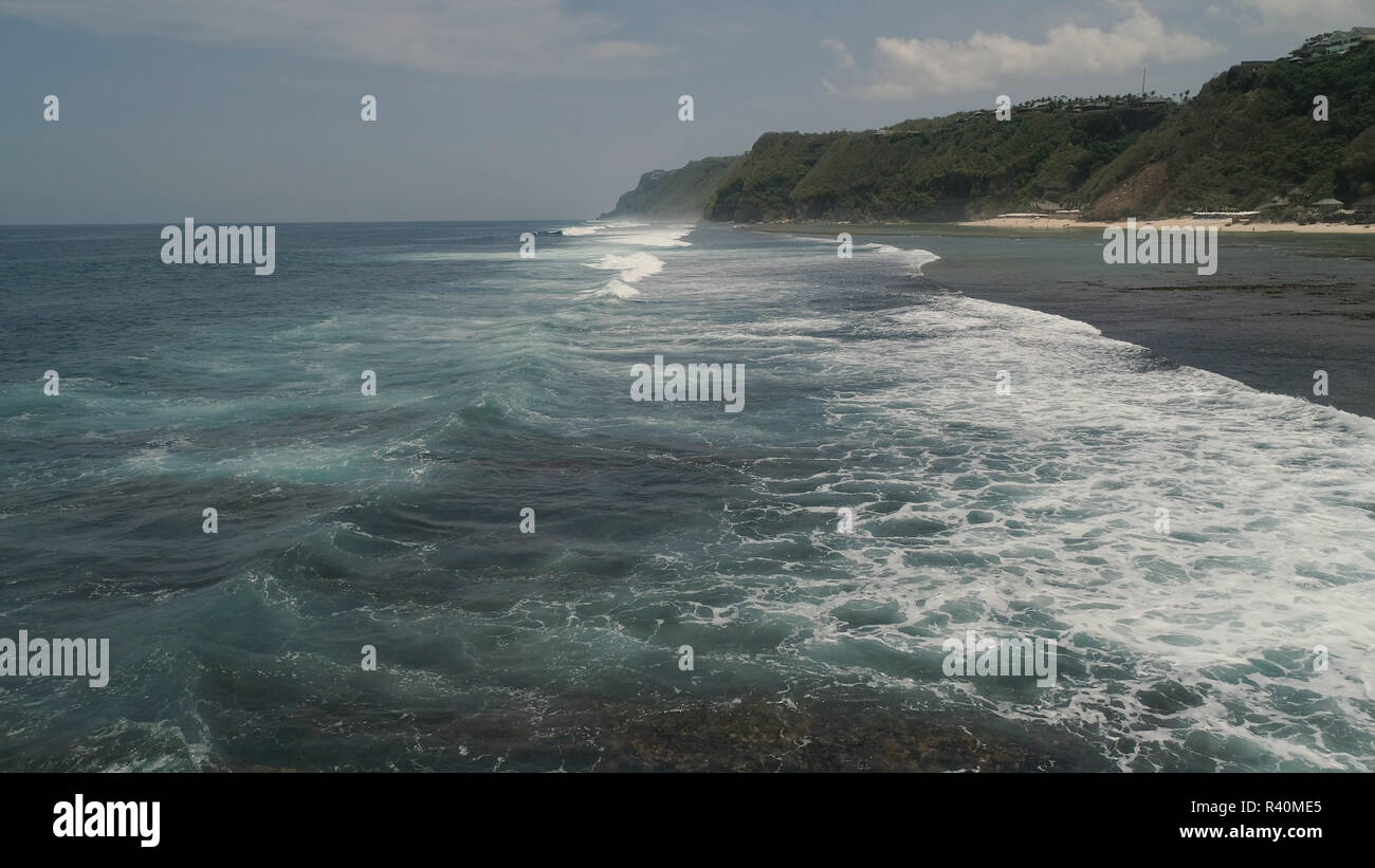 Aerial view seascape big ocean waves surf. tropical landscape waves crushing on coral reef. Bali,Indonesia. Travel concept. Stock Photo