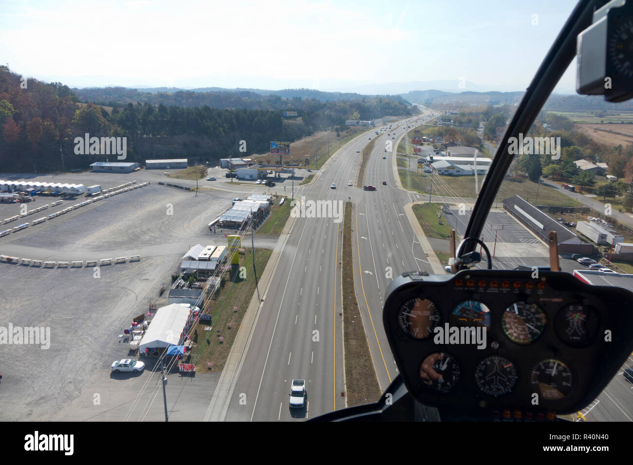 Sightseeing helicopter over Sevierville, Tennessee, heading for the Great Smoky Mountain National Park Stock Photo