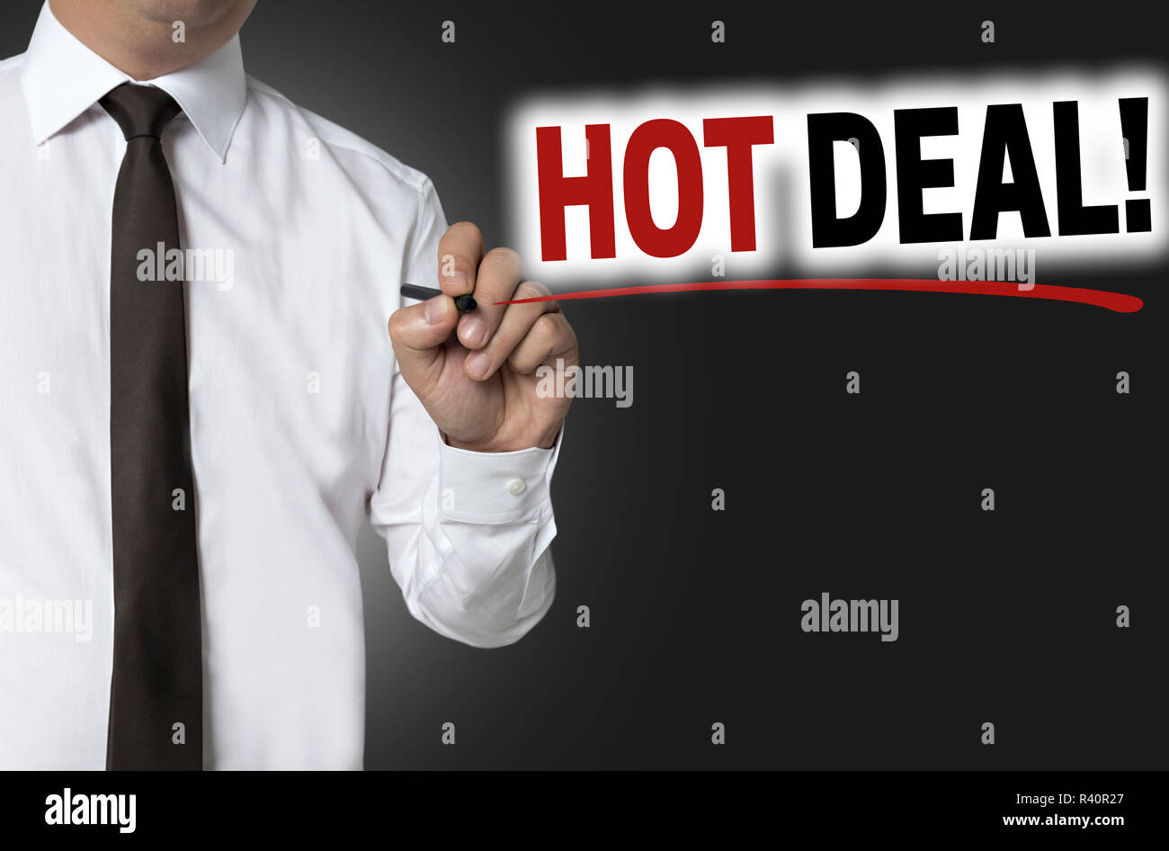 hot deal is written by businessman background concept - Stock Image