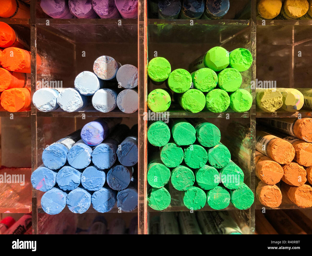 wax crayons many colors - multicolored pens in shelf - Stock Image