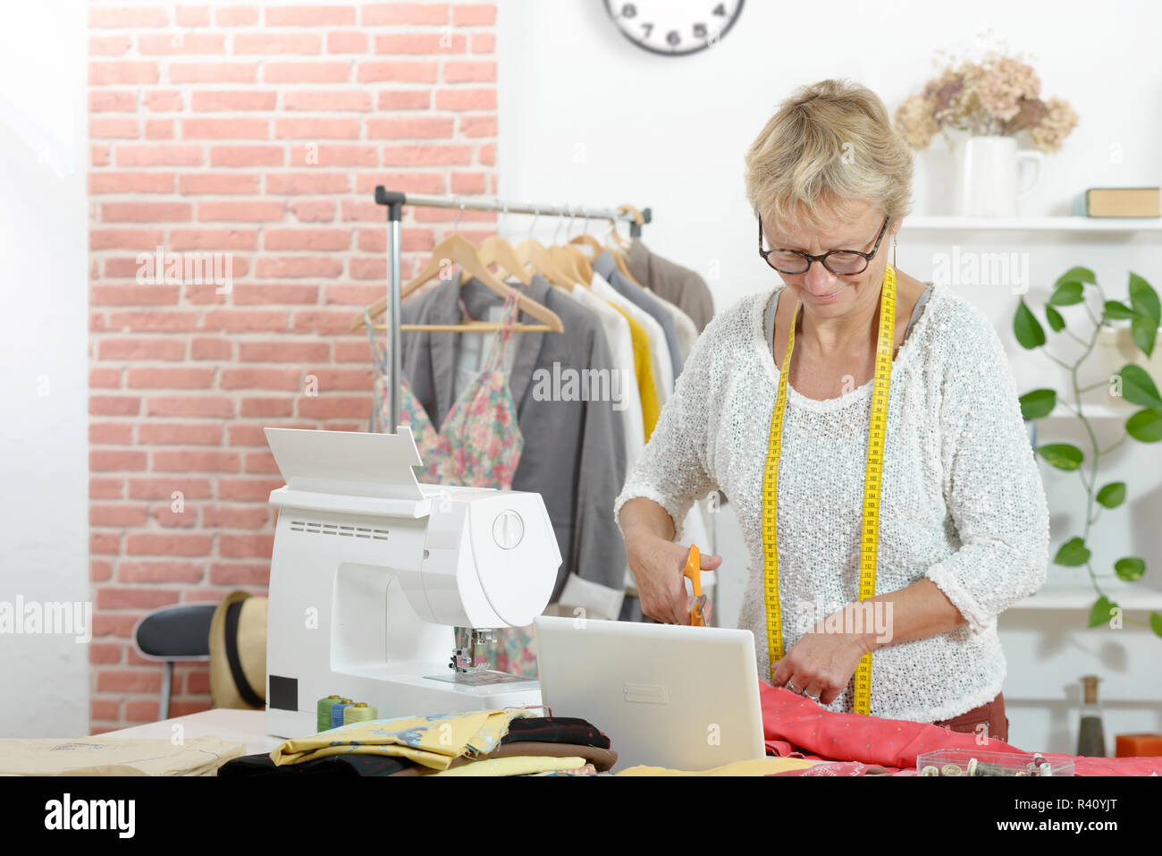 blonde woman in a sewing workshop Stock Photo