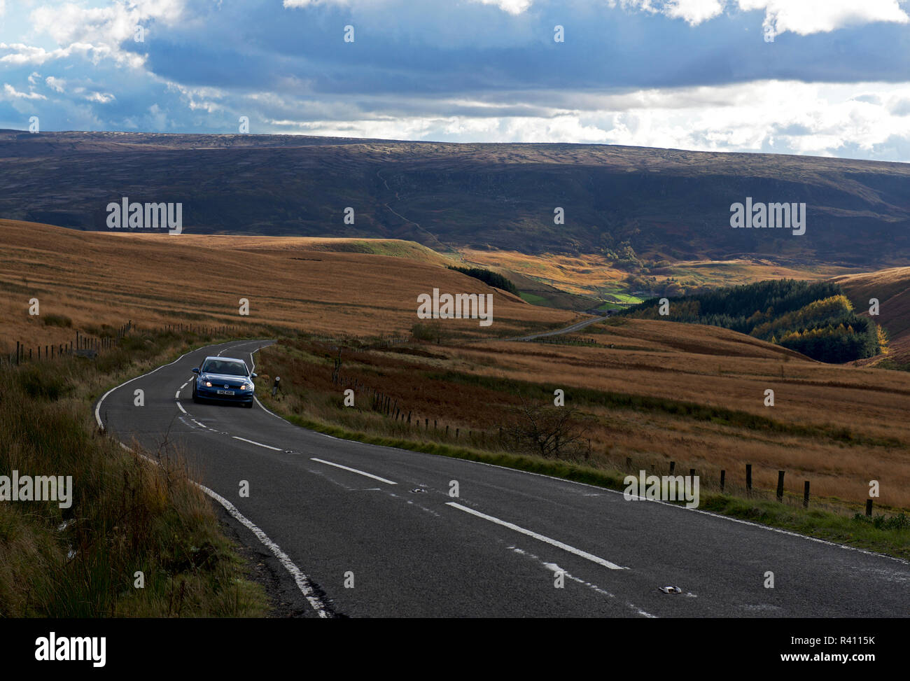 Car on road, Holme Moss, West Yorkshire, England UK - Stock Image