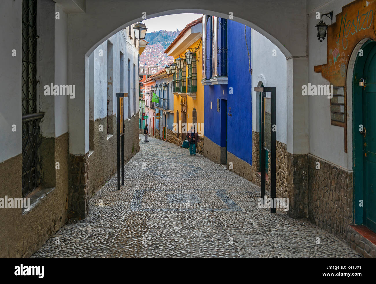 People walking by the coloorful Jaen street with a Spanish colonial style architecture in the historic city center of La Paz, Bolivia. - Stock Image