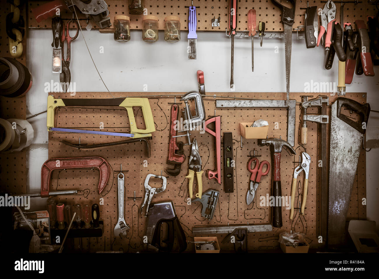 Tools hanging at a home workbench. - Stock Image