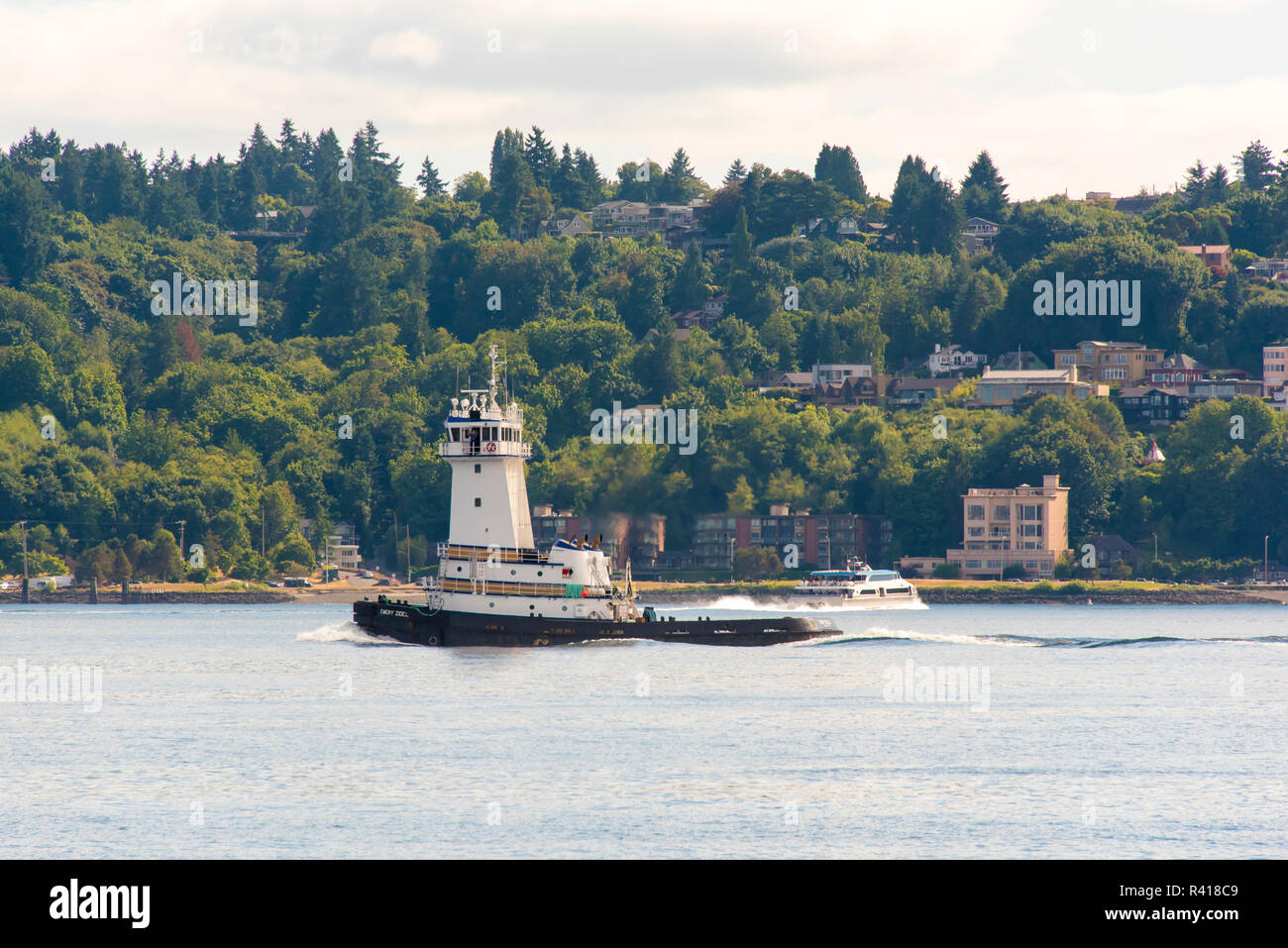 USA, Washington State, Puget Sound. Emery Zidell tugboat. Unique tower. Passes Bremerton fast ferry - Stock Image