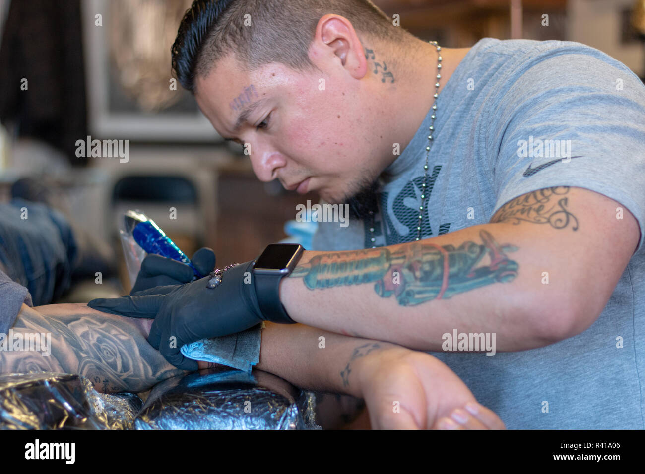 Tattoo Artis tattoos a man in Reno Nevada United States Stock Photo ...