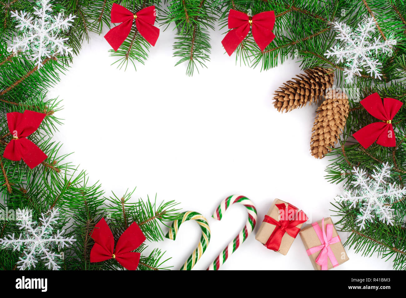 Christmas frame decorated with snowflakes and red bows isolated on white background with copy space for your text - Stock Image