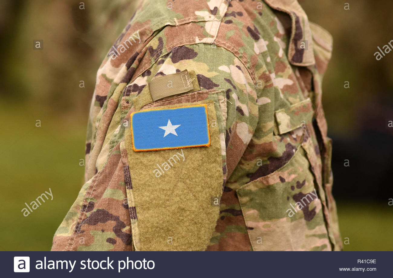 Somalia flag on soldiers arm (collage). - Stock Image