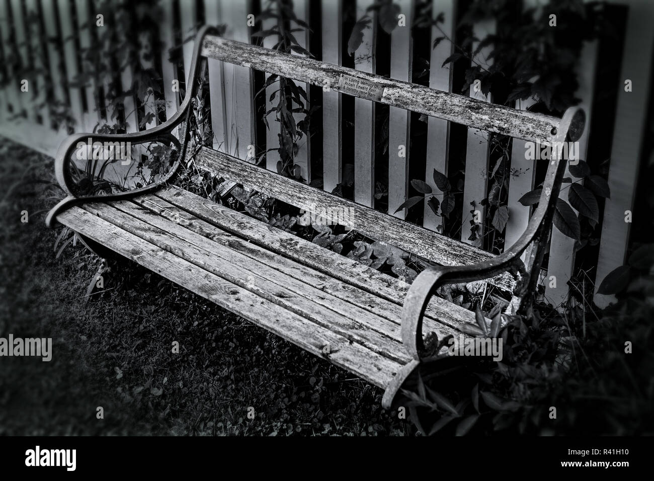 Very old and wrecked memorial bench. N/B - Stock Image