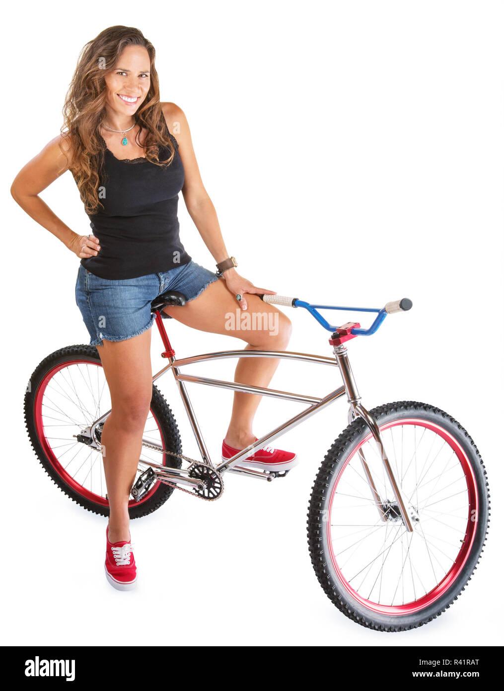 Smiling Woman on Mountain Bike - Stock Image