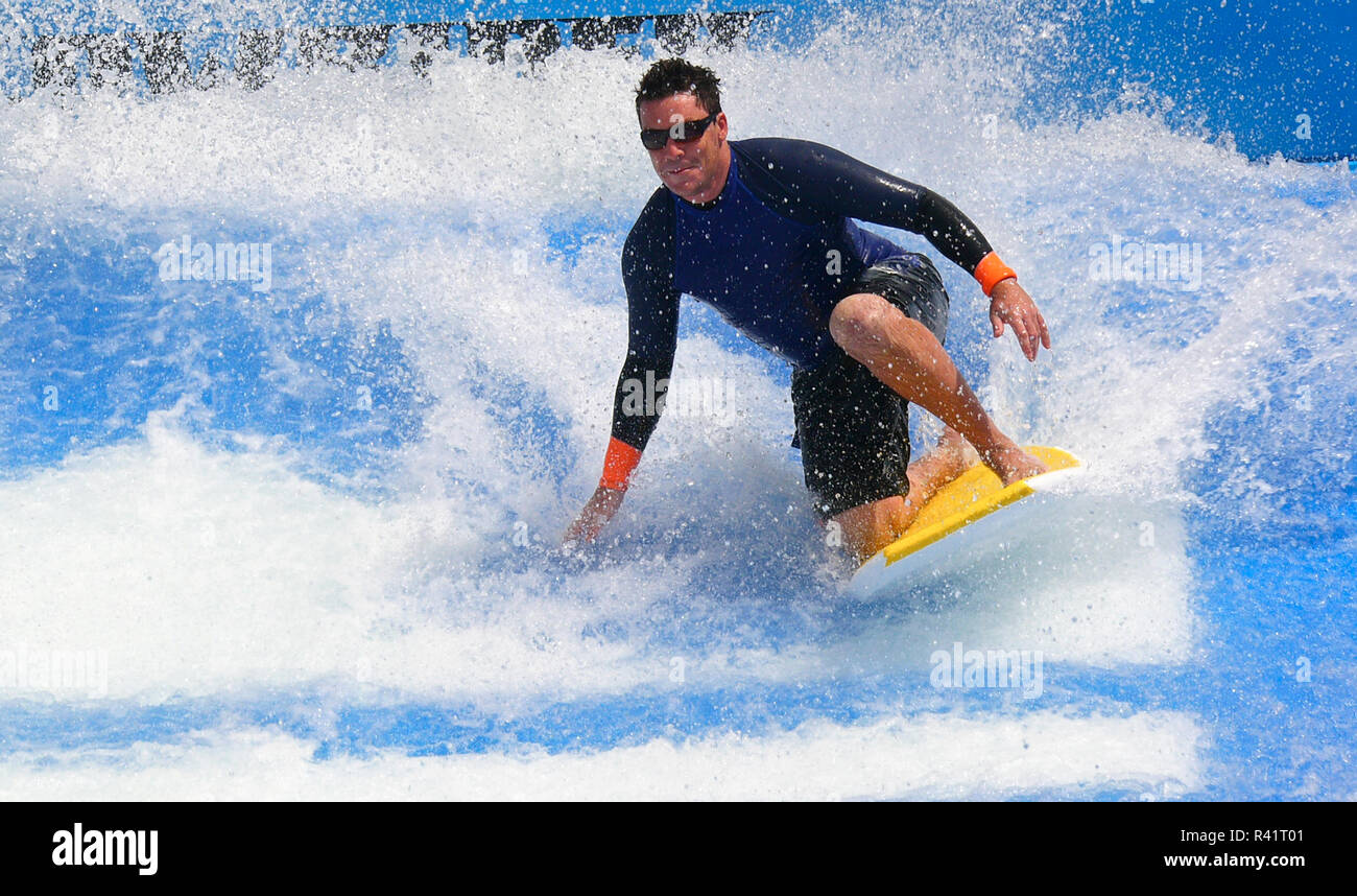 A surfer on the Flowrider wave system on Royal Caribbean International's cruise ship, Liberty of the Seas. - Stock Image