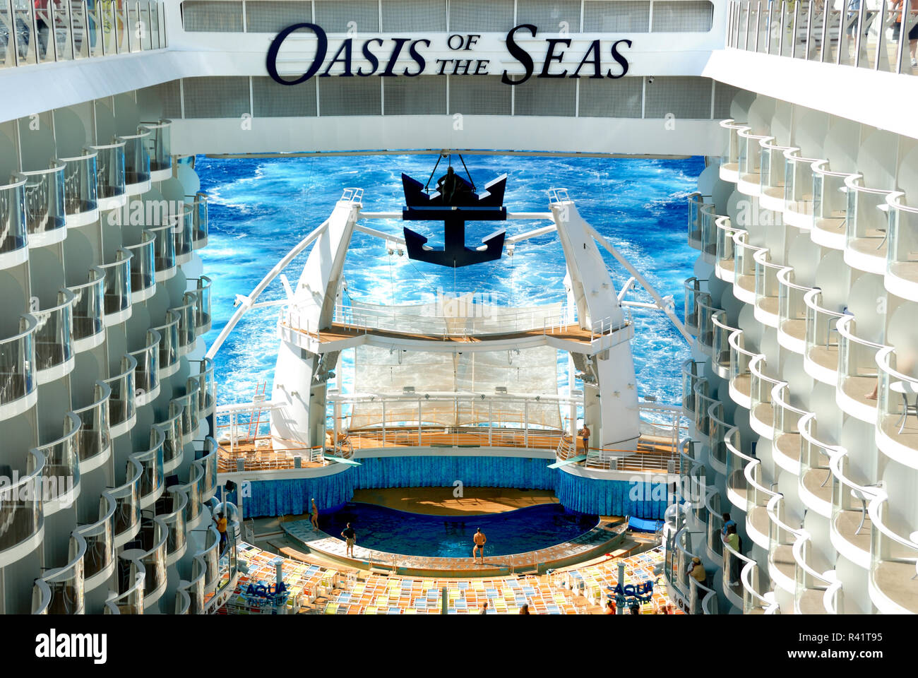 The incredible Aqua Theatre on the aft of Royal Caribbean's Oasis of the Seas hosts nighttime entertainment featuring high divers and synchronized swi - Stock Image