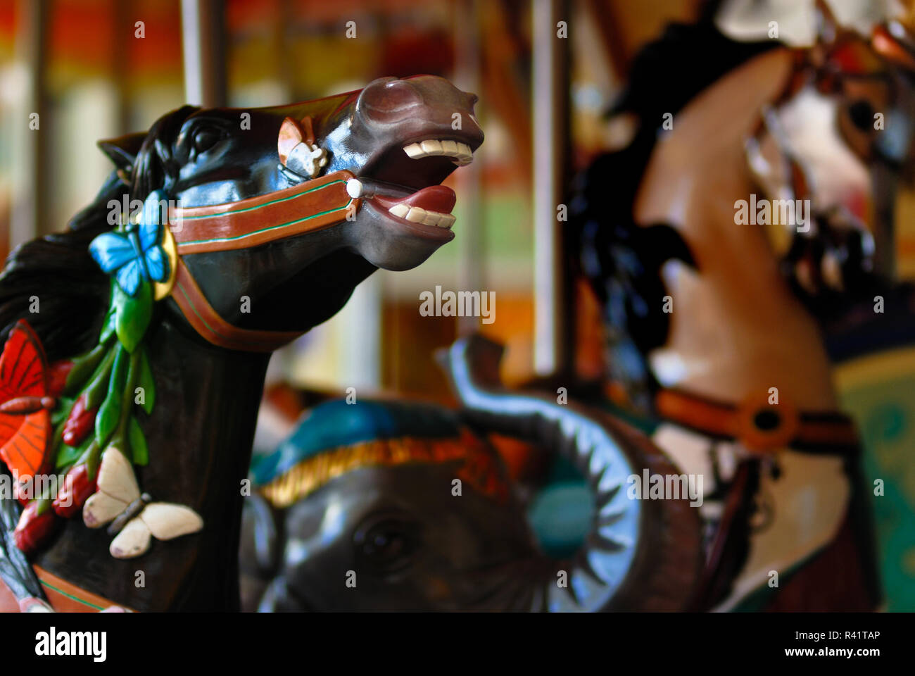 The carousel horses on the Boardwalk merry go round on the cruise ship Oasis of the Seas. - Stock Image