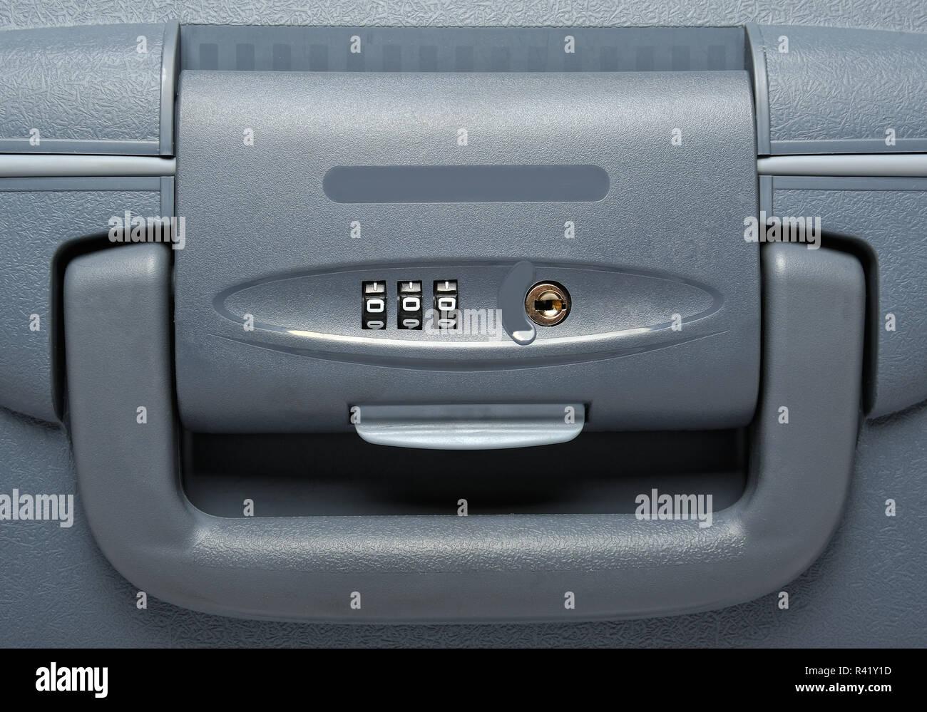 Combination lock on suitcase - Stock Image