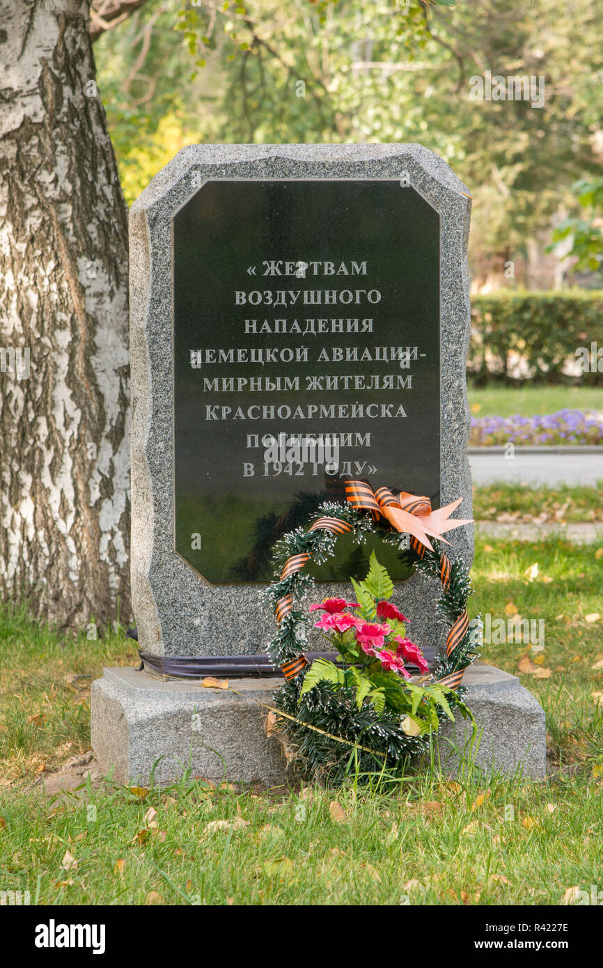The memorial slab to the victims of an air attack by German aircraft - Krasnoarmeisk civilians who died in 1942 - Stock Image